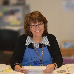 teacher at desk