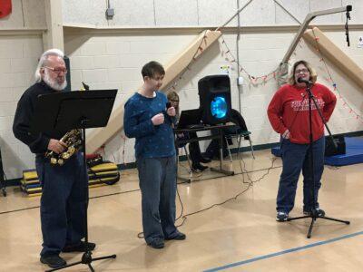Steve Vitto accompanies Beth VanAuker and Samantha Stephenson on his saxophone.